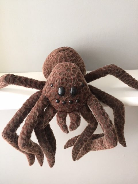 large brown soft toy spider from Harry Potter.