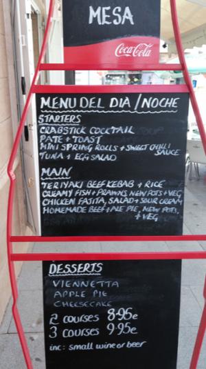 a black menu del dia sign