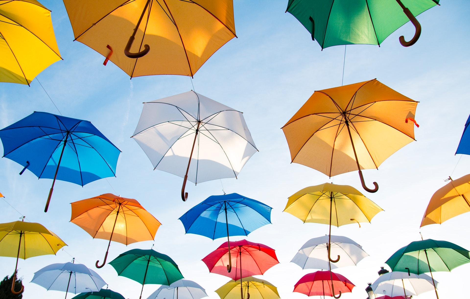 lots of pretty umbrellas in the sky